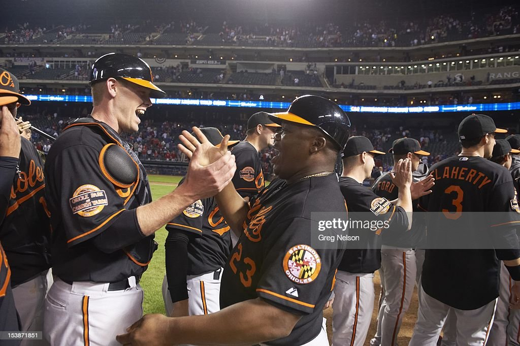 Baltimore Orioles Matt Wieters (32) victorious with first base coach Wayne Kirby (23) after winning game vs Texas Rangers at Rangers Ballpark. Greg Nelson F52 )