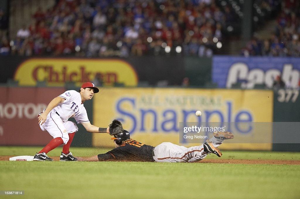 Baltimore Orioles Nate McLouth (9) in action, safe at second base vs Texas Rangers Ian Kinsler (5) at Rangers Ballpark. Greg Nelson F40 )