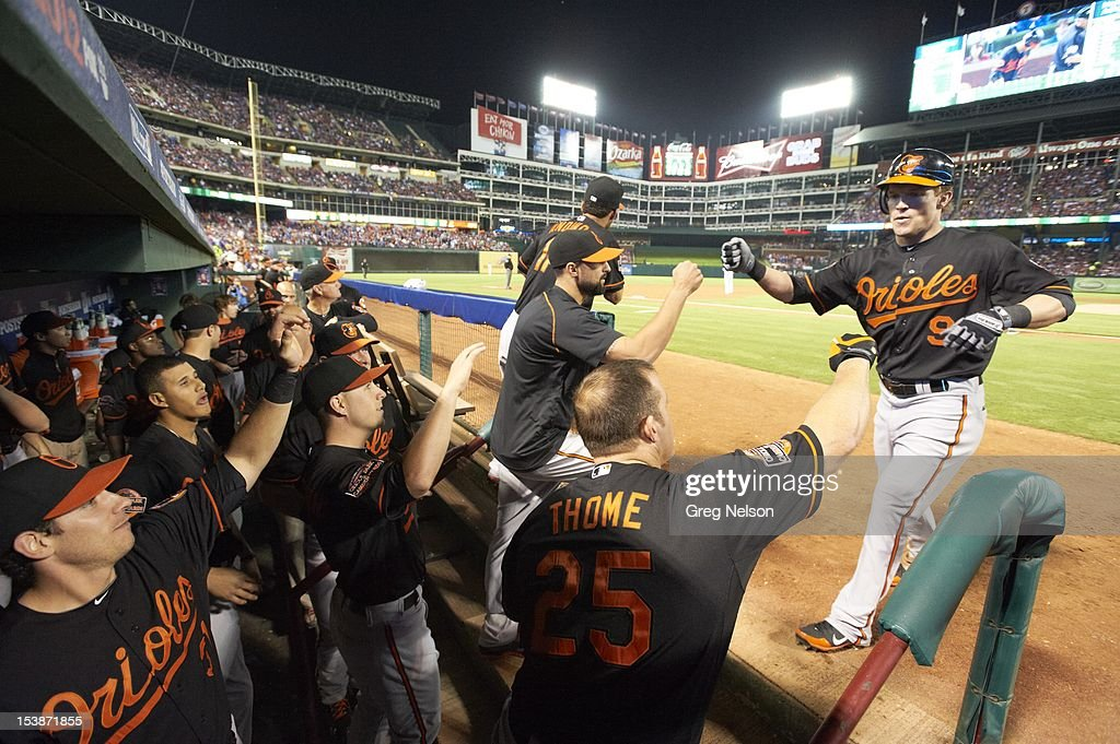 Baltimore Orioles Nate McLouth (9) victorious in front of dugout with teammates during game vs Texas Rangers at Rangers Ballpark. Greg Nelson F2 )