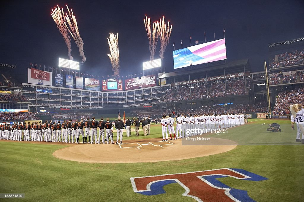 Overall view of fireworks over Texas Rangers and Baltimore Orioles players during national anthem before game at Rangers Ballpark. Greg Nelson F24 )