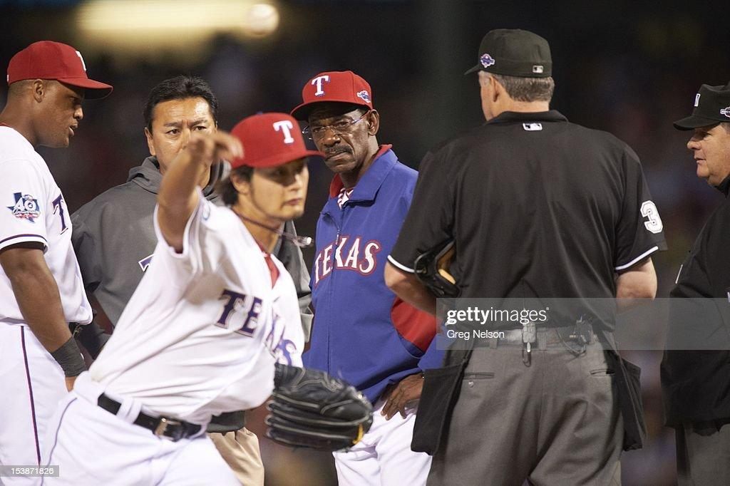 Texas Rangers manager Ron Washington (38) checking on Yu Darvish (11) during game vs Baltimore Orioles at Rangers Ballpark. Greg Nelson F226 )