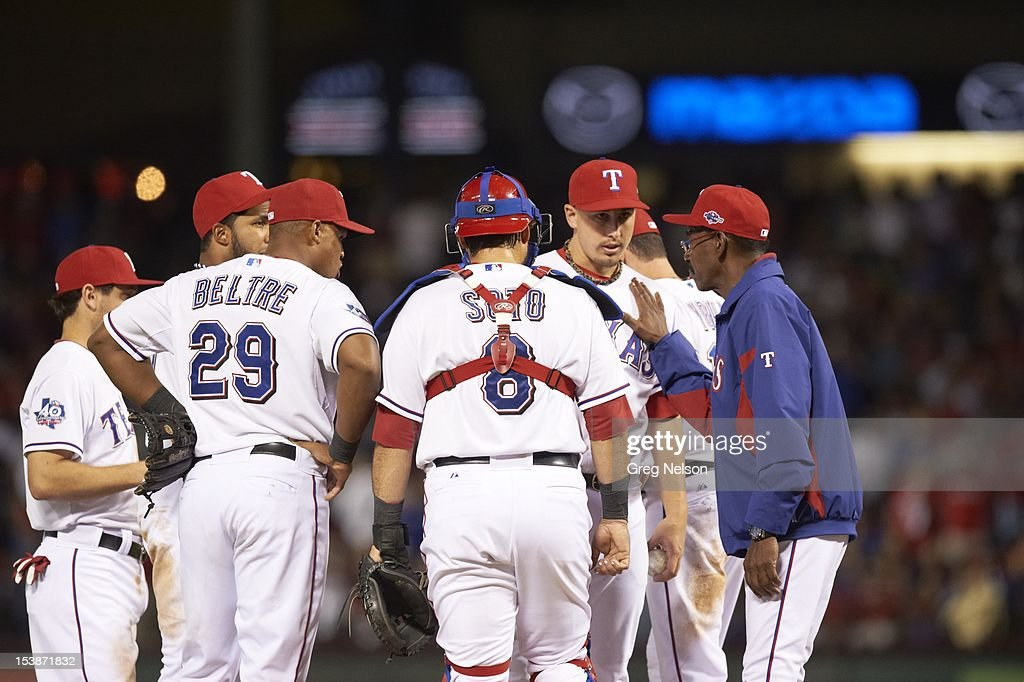 Texas Rangers manager Ron Washington (38) meeting on mound with players during game vs Baltimore Orioles at Rangers Ballpark. Greg Nelson F306 )