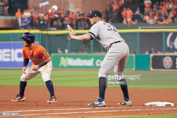 ALCS Playoffs Houston Astros Jose Altuve taking lead off first base vs New York Yankees Greg Bird at Minute Maid Park Game 1 Houston TX CREDIT Greg...