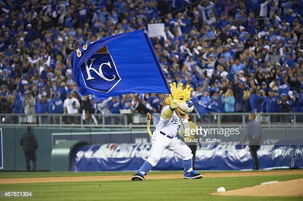 ALCS Playoffs Kansas City Royals mascot Sluggerr waving flag with logo on field during game vs Baltimore Orioles at Kauffmann Stadium Game 3 Kansas...