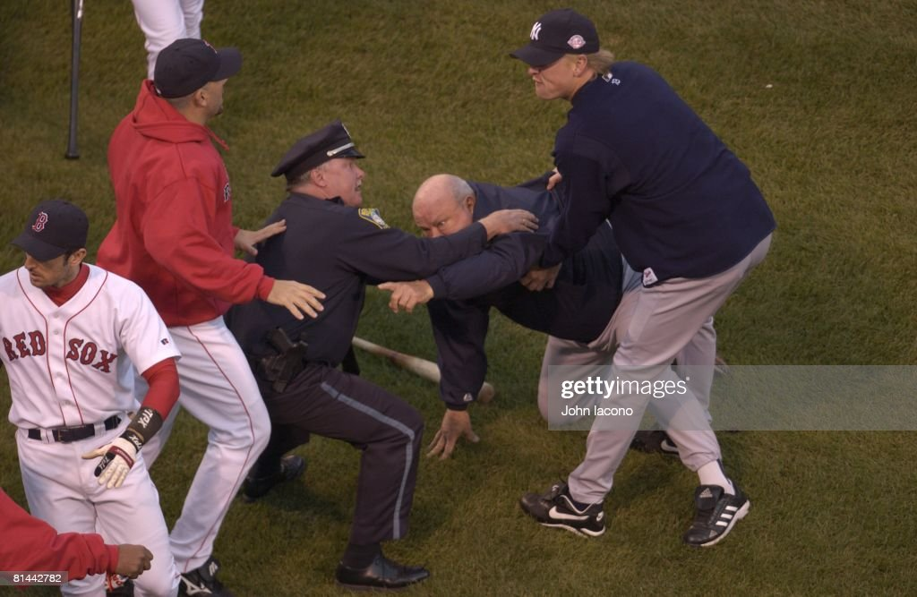 ALCS Playoffs, New York Yankees bench coach <a gi-track='captionPersonalityLinkClicked' href=/galleries/search?phrase=Don+Zimmer&family=editorial&specificpeople=215376 ng-click='$event.stopPropagation()'>Don Zimmer</a> upset, getting held by police after fight with Boston Red Sox <a gi-track='captionPersonalityLinkClicked' href=/galleries/search?phrase=Pedro+Martinez&family=editorial&specificpeople=171773 ng-click='$event.stopPropagation()'>Pedro Martinez</a> during Game 3, Boston, MA
