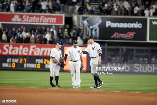 ALCS Playoffs New York Yankees Brett Gardner Aaron Hicks and Aaron Judge victorious during game vs Houston Astros at Yankee Stadium Game 3 Bronx NY...