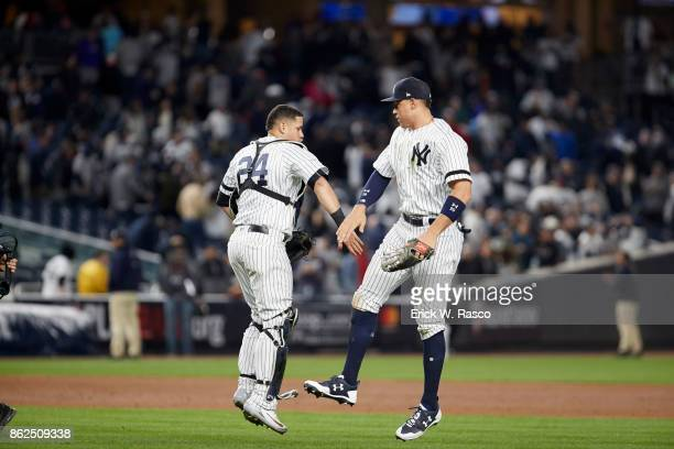 ALCS Playoffs New York Yankees Gary Sanchez victorious with Aaron Judge after winning game vs Houston Astros at Yankee Stadium Game 3 Bronx NY CREDIT...