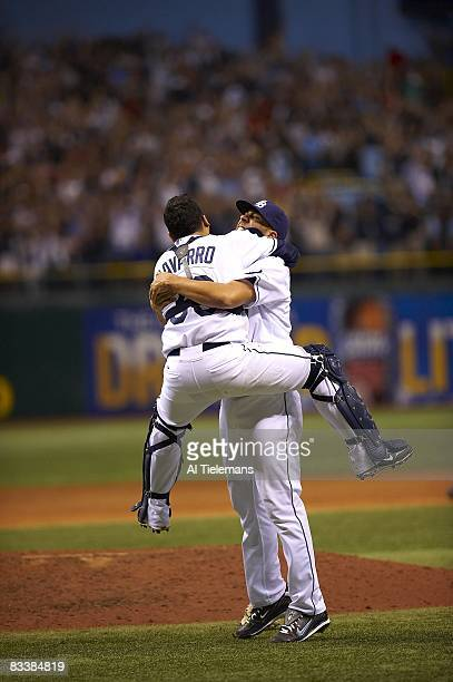 ALCS Playoffs Tampa Bay Rays David Price victorious hugging Dioner Navarro after winning Game 7 and series vs Boston Red Sox St Petersburg FL CREDIT...