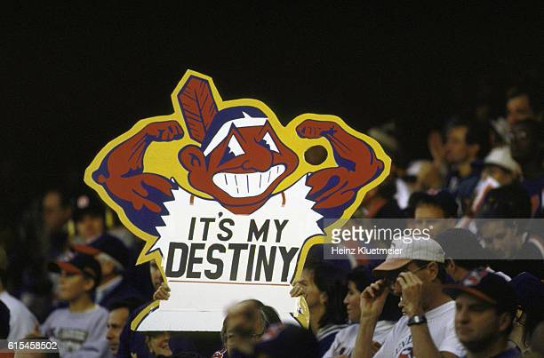 ALCS Playoffs View of fan in stands holding sign that reads IT'S MY DESTINY with muscled Chief Wahoo logo during game vs Baltimore Orioles at Jacobs...