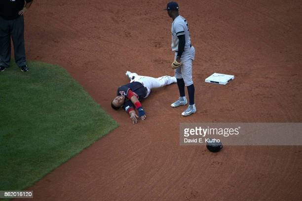 ALDS Playoffs Aerial view of Cleveland Indians Jose Ramirez down with injury at second base with New York Yankees Didi Gregorius looking on at...