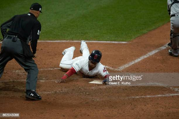 ALDS Playoffs Cleveland Indians Jose Ramirez in action sliding head first into home plate vs New York Yankees at Progressive Field Game 1 Cleveland...