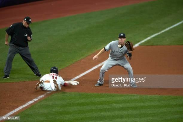 ALDS Playoffs Cleveland Indians Jose Ramirez in action sliding into thrid base vs New York Yankees Todd Frazier at Progressive Field Game 1 Cleveland...