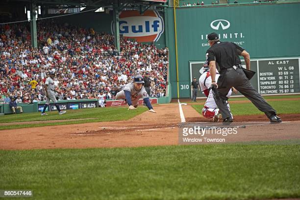 ALDS Playoffs Houston Astros George Springer in action diving towards home plate and scoring run vs Boston Red Sox Sandy Leon at Fenway Park Game 3...