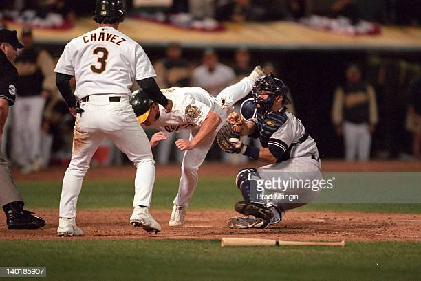 ALDS Playoffs New York Yankees Jorge Posada in action tagging out Oakland Athletics Jeremy Giambi at home plate at Network Associates Coliseum Game 1...