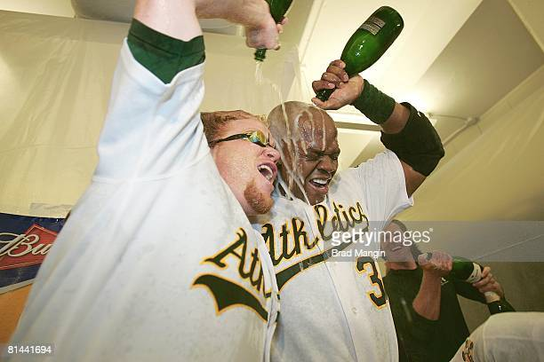 Baseball ALDS Playoffs Oakland Athletics Frank Thomas and Bobby Kielty victorious with champagne in locker room after winning Game 3 and series vs...