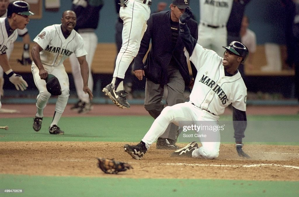 Seattle Mariners Ken Griffey Jr. (24) in action, scoring game winning run to win series vs New York Yankees at Kingdome. Game 5. Scott Clarke X49366 )