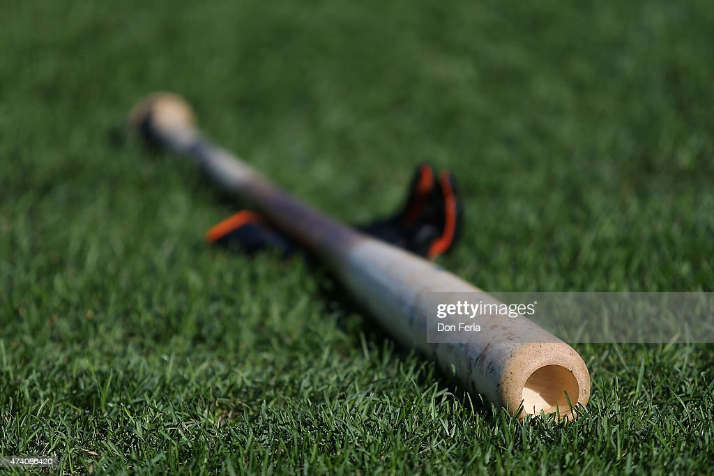 A baseball and batting glove sits on the infield grass before play between the San Francisco Giants and the visiting Los Angeles Dodgers at ATT Park...
