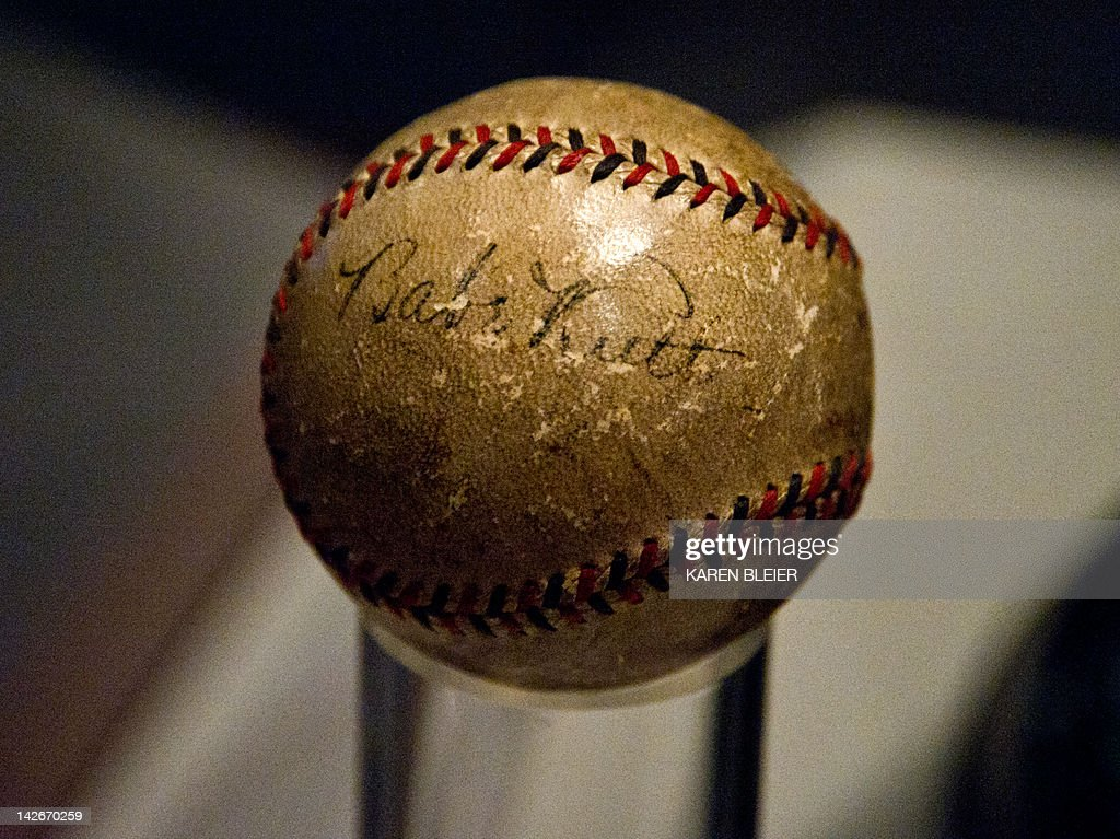 """A baseball autographed by legendary player Babe Ruth is seen on display on April 11, 2012 at the Smithsonian Mueseum of American History in Washington, DC, during the press preview for """"American Stories,"""" a new exhibition showcasing stories about the American experience, which opens on April 12. The exhibition features more than 100 objects, which take visitors on a chronological view of US history that spans the Pilgrims' 1620 arrival in Plymouth, Massachusetts , through the 2008 Presidential election. AFP PHOTO/Karen BLEIER"""