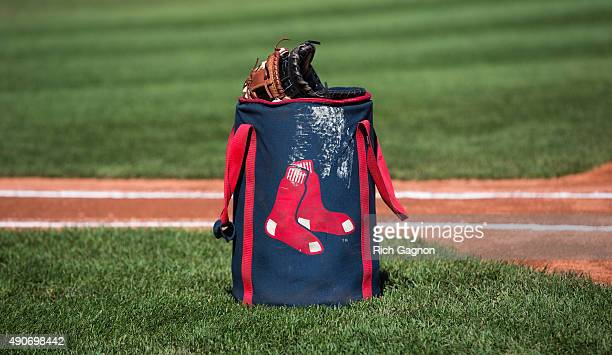A baseball bag with the Boston Red Sox logo sits on the grass before a game between the Boston Red Sox and the Baltimore Orioles at Fenway Park on...