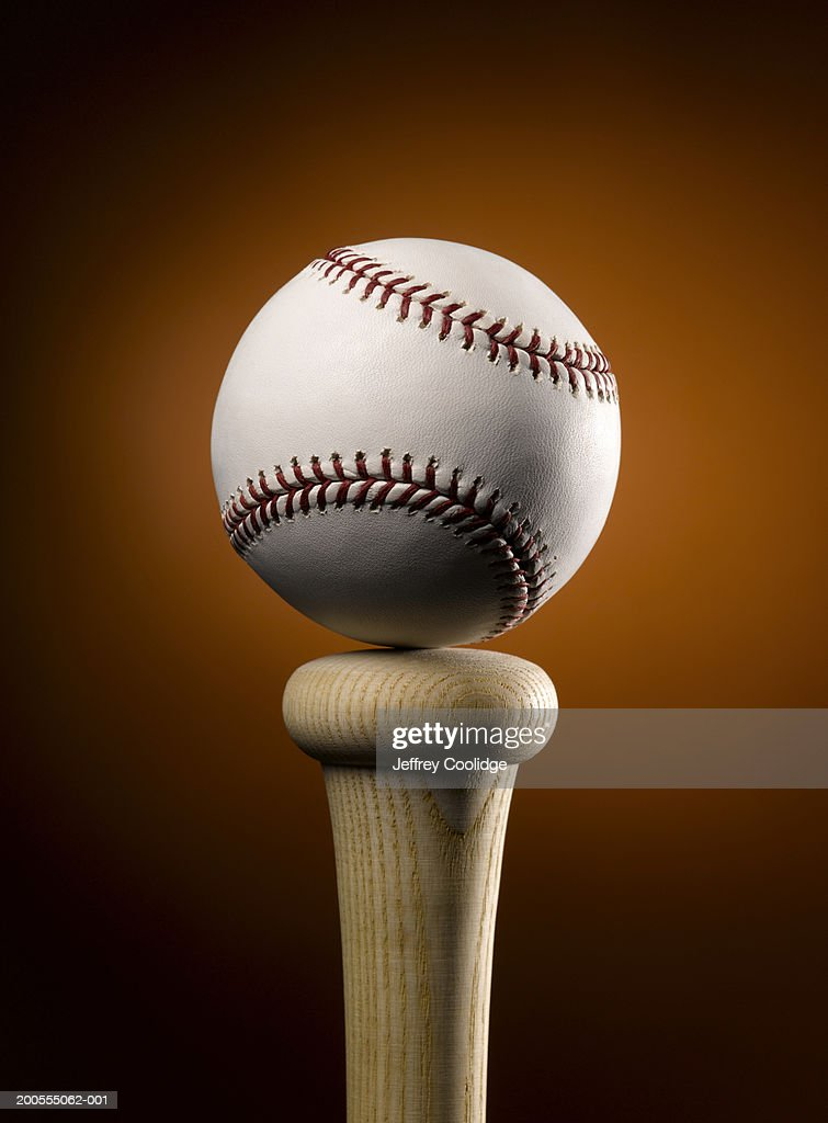Baseball balancing on top of bat, close-up : Photo