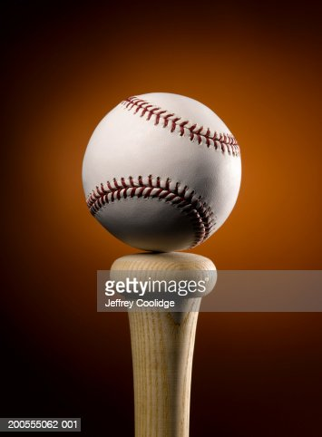 Baseball balancing on top of bat, close-up : Stock Photo