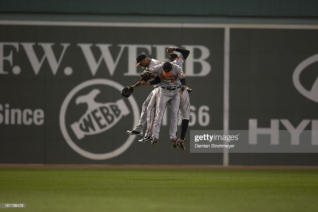 Baltimore Orioles Chris Dickerson (36), Nick Markakis (21) and Adam Jones (10) victorious after winning game vs Boston Red Sox at Fenway Park. Damian Strohmeyer F31 )