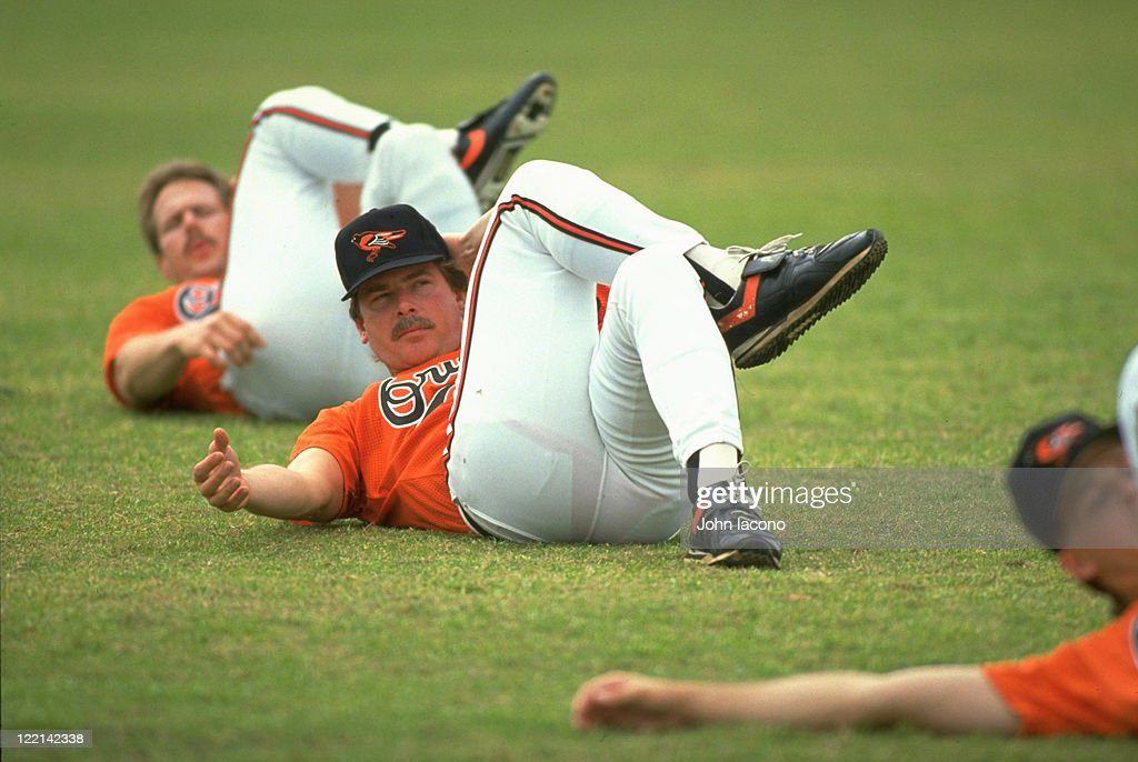 Baltimore Orioles Mike Flanagan stretching during spring training workout for pitchers and catchers at Twin Lakes Park facility Sarasota FL CREDIT...
