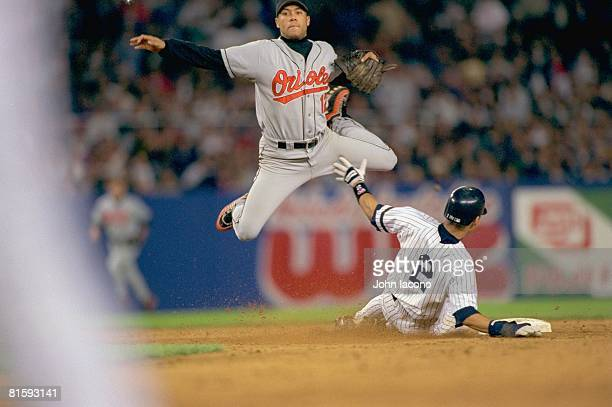 Baseball Baltimore Orioles Roberto Alomar in action attempting to turn double play vs New York Yankees Derek Jeter Bronx NY 9/17/1996