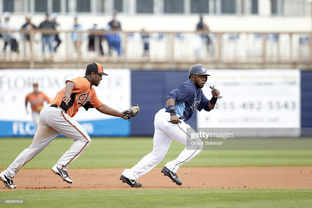 Baltimore Orioles Yamaico Navarro (58) in action vs Tampa Bay Rays Jason Bourgeois (66) during spring training game at Charlotte Sports Park. Chuck Solomon F111 )