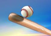 Baseball bat hitting ball under blue sky