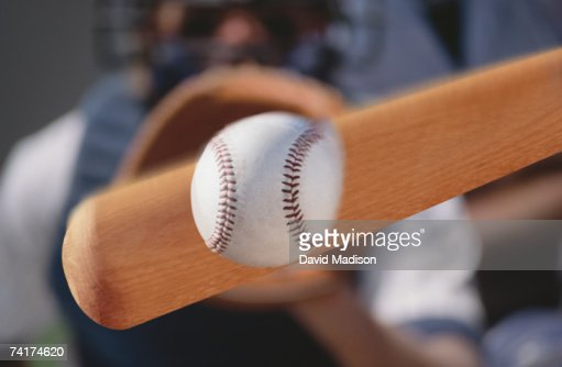 'Baseball bat hitting baseball, close-up '