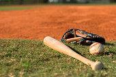 Baseball Bat Mitt and Ball on Diamond
