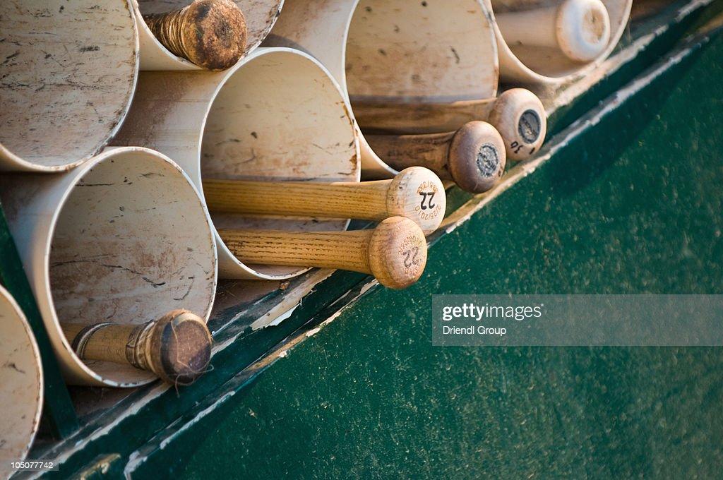 Baseball bats in the dugout
