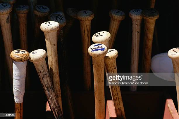 Baseball bats standing on end