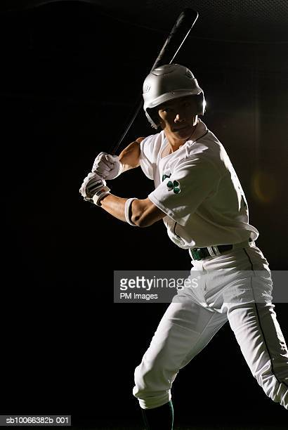 Baseball batter in batting stance, close-up