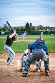 Baseball Player Swinging Bat At Home Plate