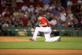 Boston Red Sox Alfredo Aceves kneeling on mound during game vs New York Yankees at Fenway Park Game 2 of doubleheader Boston MA CREDIT Damian...