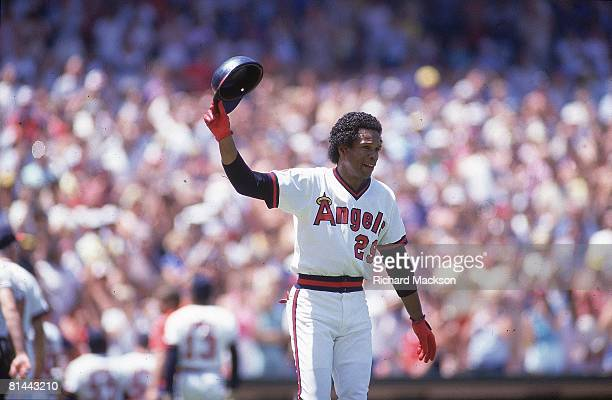 Baseball California Angels Rod Carew victorious after making 3000th career hit during game vs Minnesota Twins Anaheim CA 8/4/1985