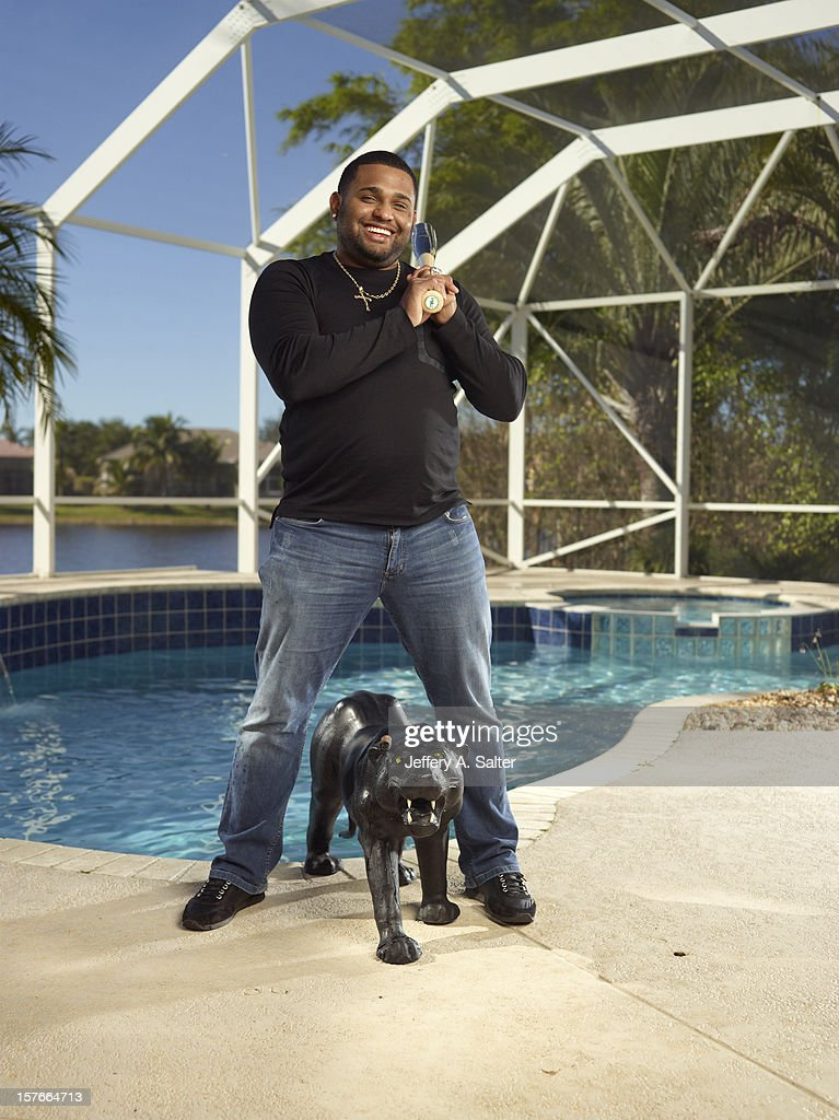 Casual portrait of San Francisco Giants Pablo Sandoval posing during photo shoot at his home. Jeffery A. Salter F224 )