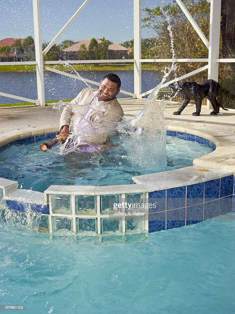 Casual portrait of San Francisco Giants third baseman Pablo Sandoval posing during photo shoot on his pool at home. Jeffery A. Salter F68 )