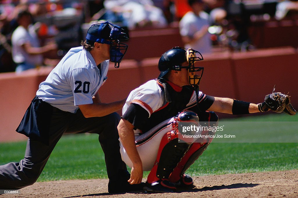 Baseball catcher and umpire at game : Stock Photo