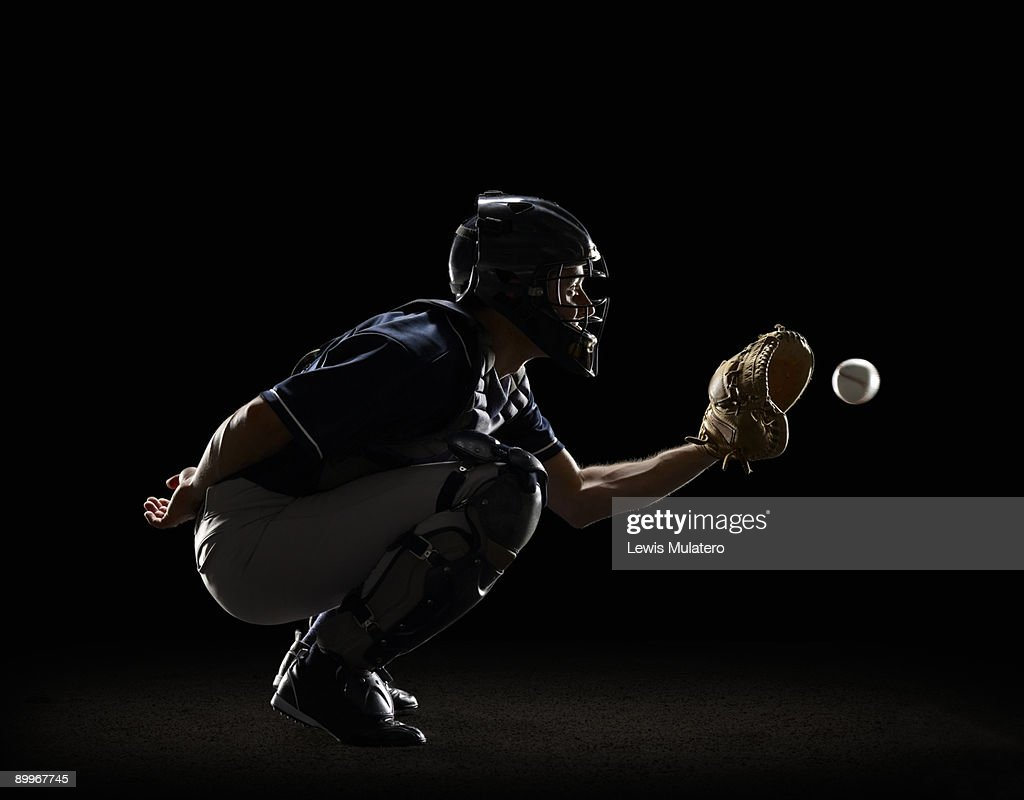 Baseball Catcher catching ball in mitt : Stock Photo