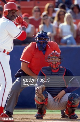 Baseball catcher giving sign, batter getting set for pitch : Stock Photo