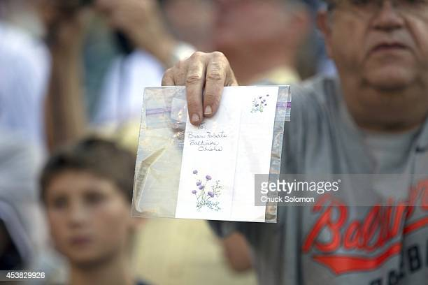 Closeup of Baltimore Orioles fan in stands holding letter addressed to New York Yankees and former Orioles second baseman Brian Roberts during game...
