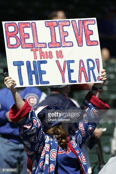 Baseball Closeup of Chicago Cubs fan with BELIEVE THIS IS THE YEAR sign during game vs Milwaukee Brewers Chicago IL 4/9/2005