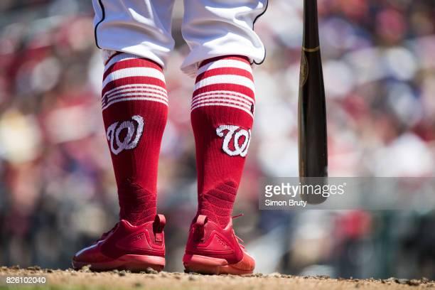 Closeup of Washington Nationals player wearing socks up high with logo during during at bat vs Colorado Rockies at Nationals Park Equipment...