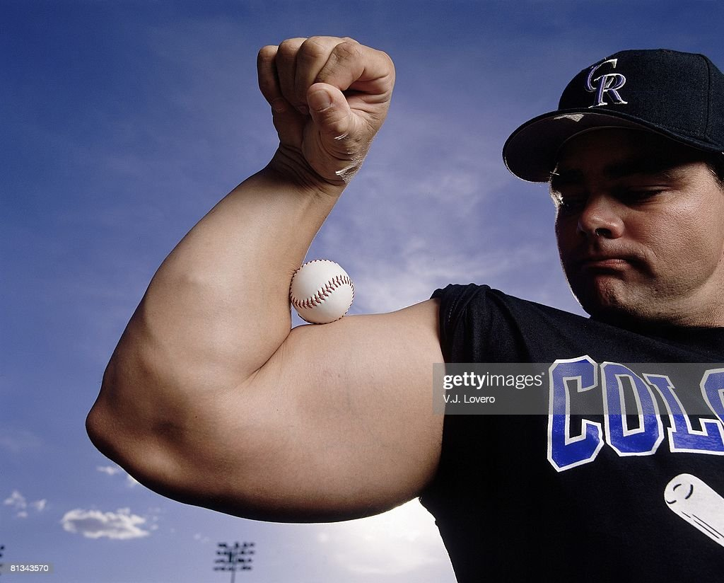 Closeup portrait of Colorado Rockies Dante Bichette flexing with ball, equipment, AZ 3/12/1998