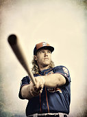 Closeup portrait of New York Mets Noah Syndergaard posing while swinging a bat during spring training photo shoot at Tradition Field Syndergaard was...
