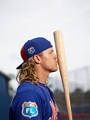 Closeup portrait of New York Mets Noah Syndergaard posing with bat during spring training photo shoot at Tradition Field Syndergaard was scouted as a...