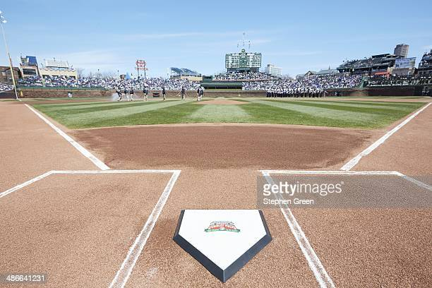 Closeup view of Wrigley Field 100 Years 19142014 logo on home plate on field during 100th Anniversary of Wrigley Field ceremony before Chicago Cubs...